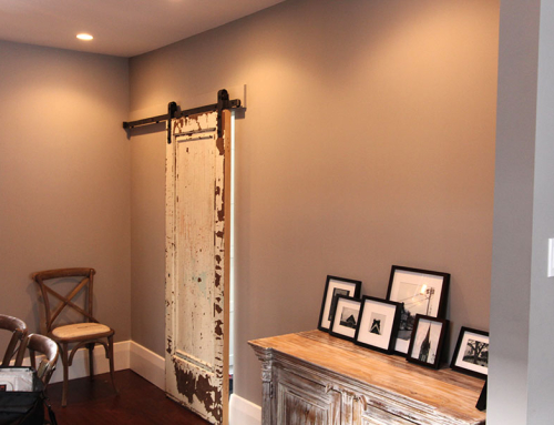 Dining room barn door leading to laundry room